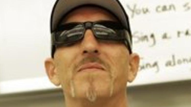 Tim Chapman wearing baseball cap and sunglasses