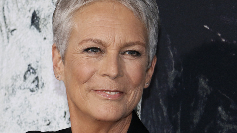 Jamie Curtis smiling at a 2018 movie premiere