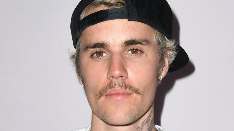 Justin Bieber wearing a hat