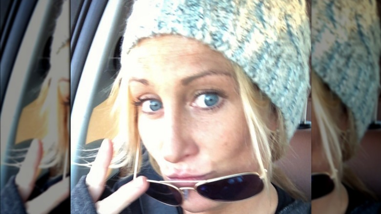 Kat Held, 2018 car selfie, wearing a beanie and sunglasses pulled down