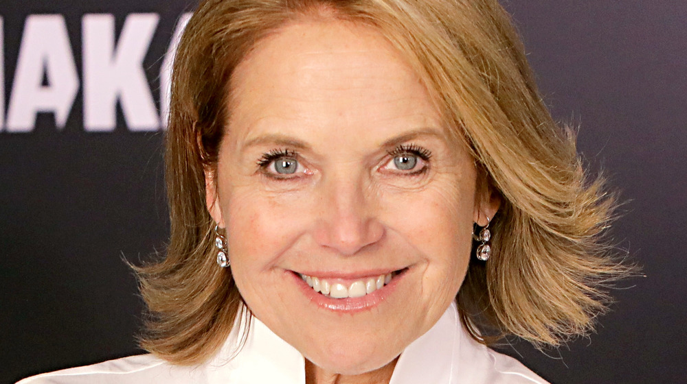 Katie Couric looking straight into the camera and smiling