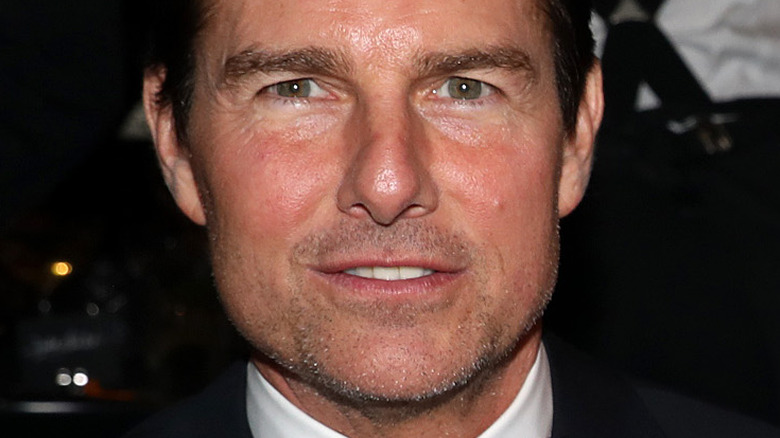 Tom Cruise looking at camera with slight smile