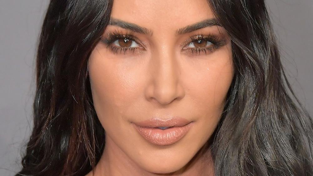 Kim Kardashian smirking