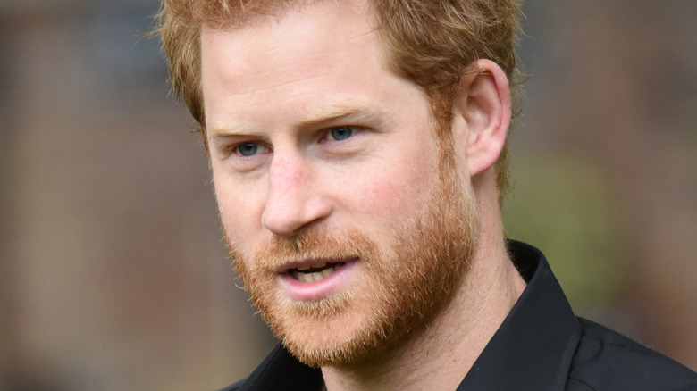 Prince Harry looks to his side