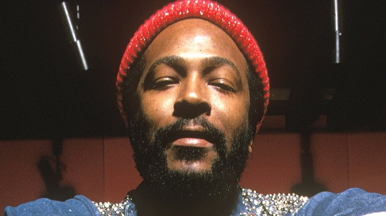 Marvin Gaye wearing a red hat