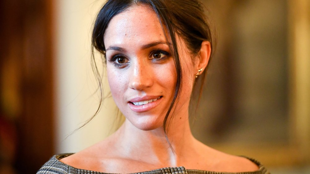 Meghan Markle chats with people inside the Drawing Room during a visit to Cardiff Castle