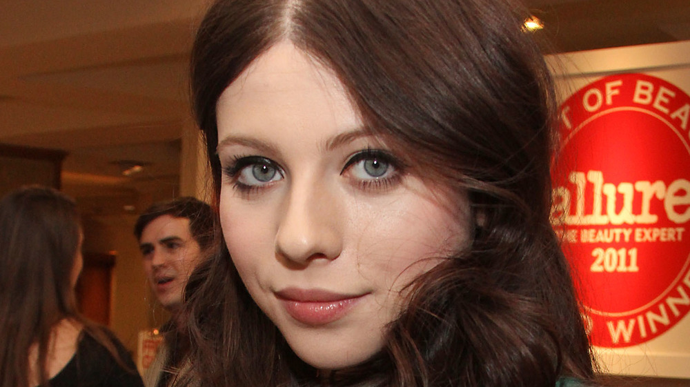 Michelle Trachtenberg looking at camera