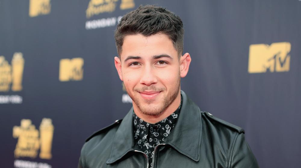 Nick Jonas smiling
