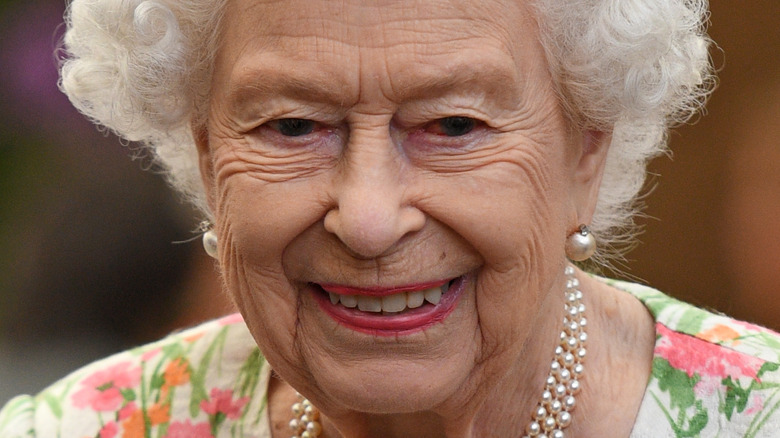 Queen Elizabeth II smiling in 2021