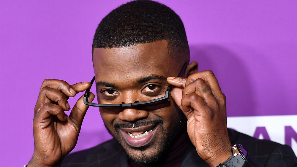 Ray J looking over sunglasses