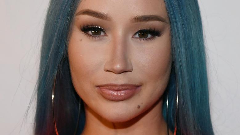 Iggy Azalea, half smiling, wearing makeup, blue hair, 2019 event