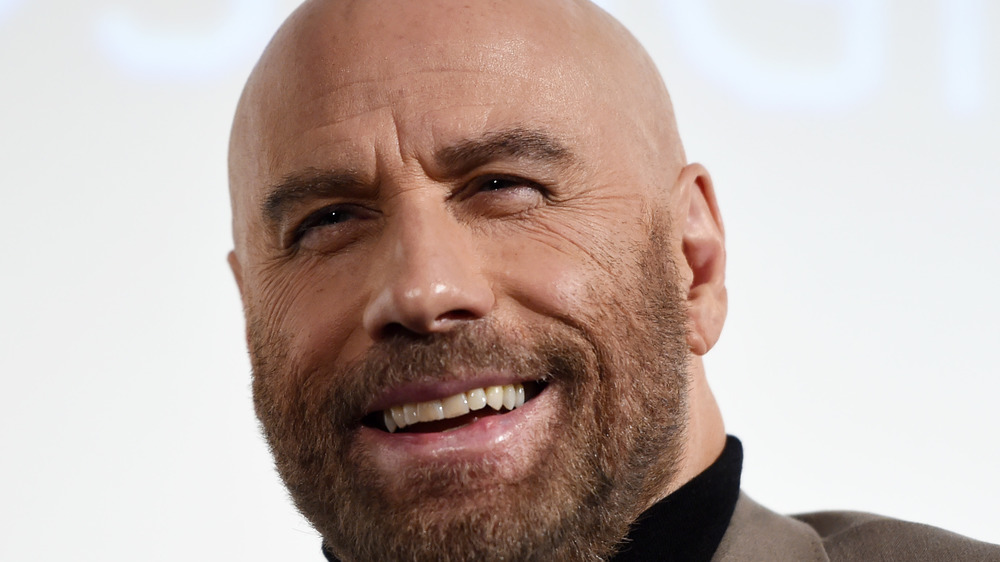 John Travolta smiles for the camera