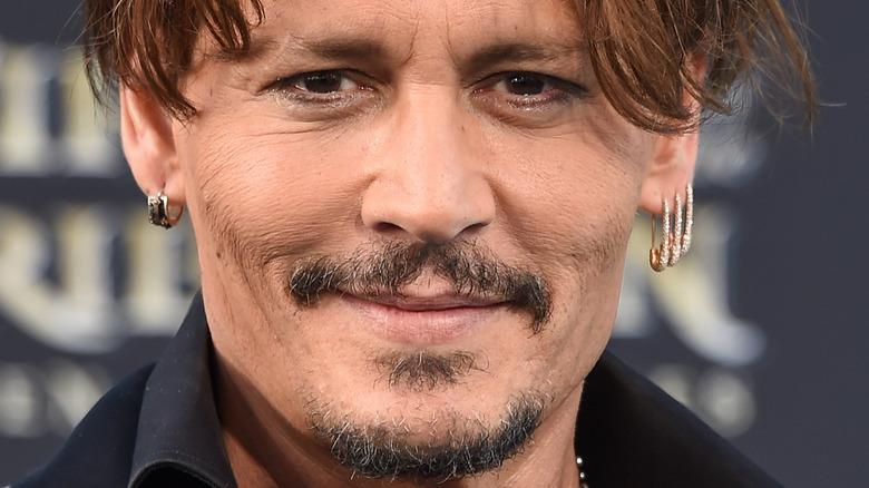 Johnny Depp smiles