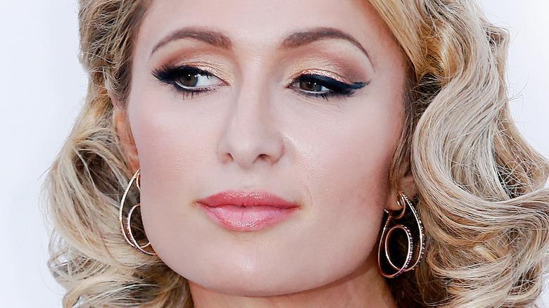 Paris Hilton not smiling