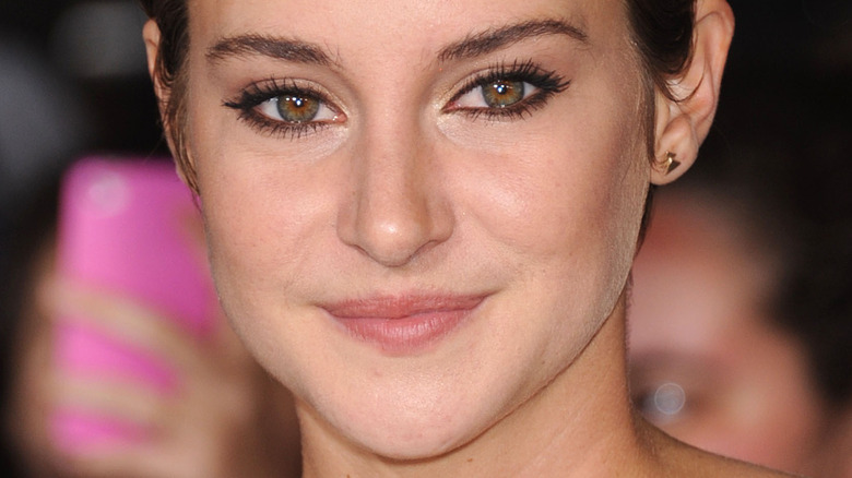 Shailene Woodley poses on the red carpet