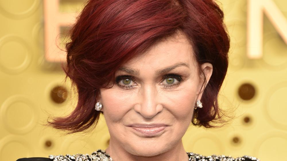 Sharon Osbourne smirking on the red carpet