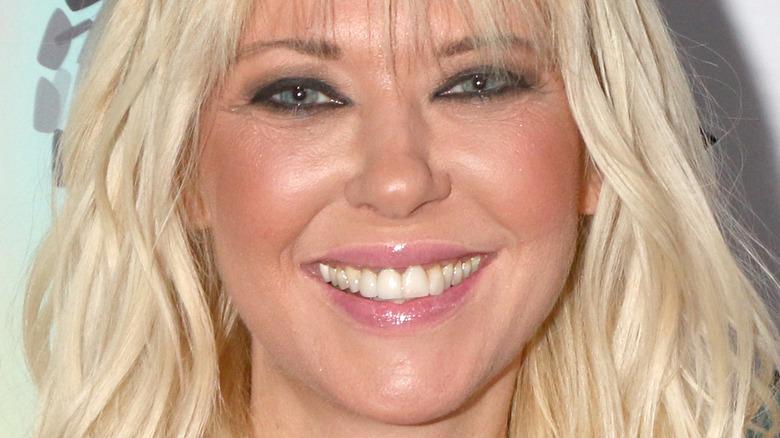 Tara Reid smiles at the camera