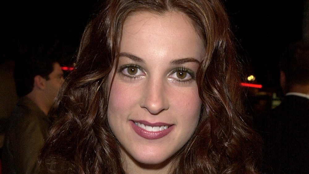 Lindsay Sloane smiling at an event in 2000