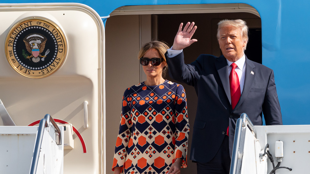 Melania and Donald Trump deplaning