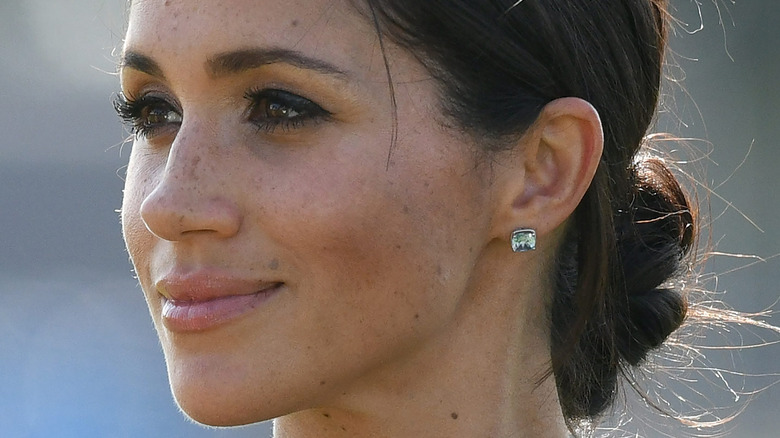 Meghan Markle looking to the side with slight smile in 2020