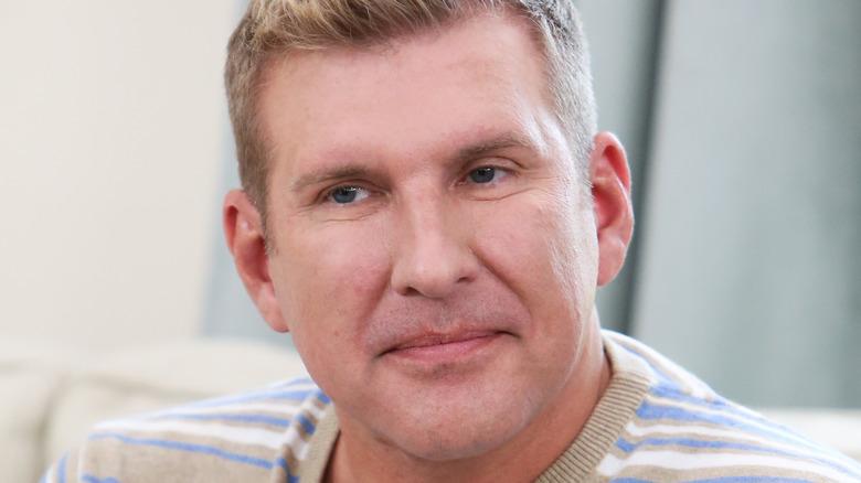 Todd Chrisley, 2018 photo, looking upset, no facial hair, not smiling