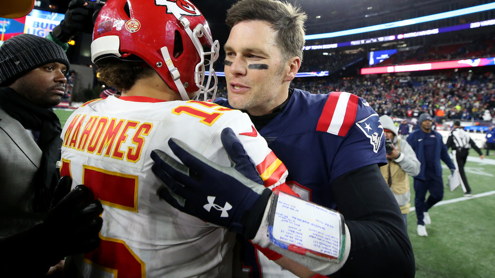 Tom Brady hugs Patrick Mahomes after a game in 2019