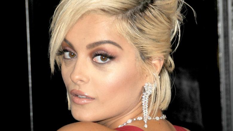 Bebe Rexha gazing over her shoulder on the Grammy Awards red carpet