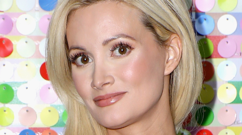 Holly Madison with a neutral expression