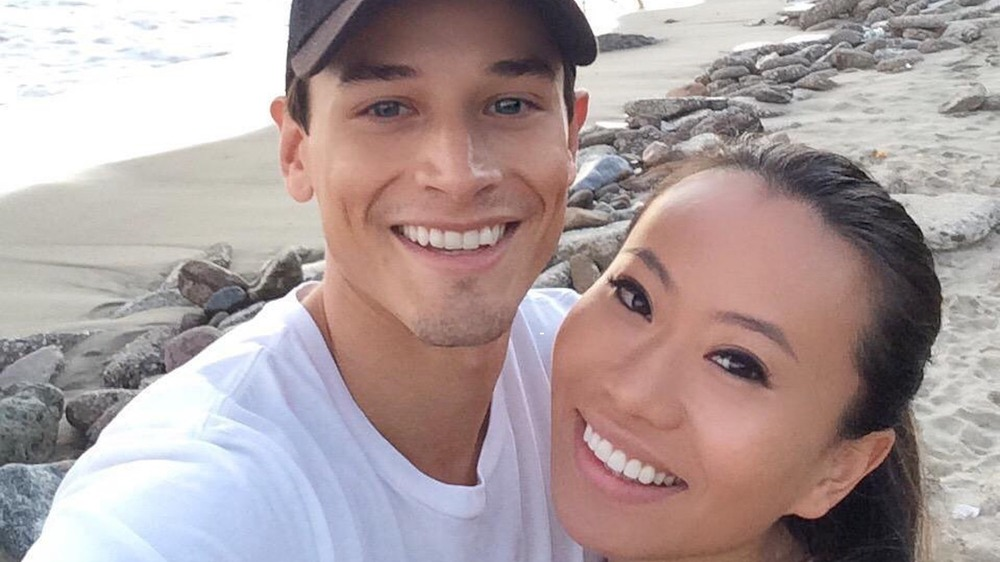 Andrew Gray and Kelly Mi Li take a selfie on the beach