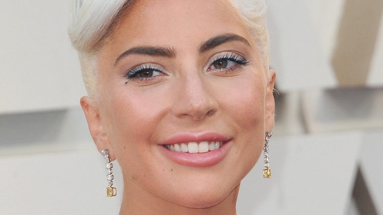 Lady Gaga smiling on the red carpet