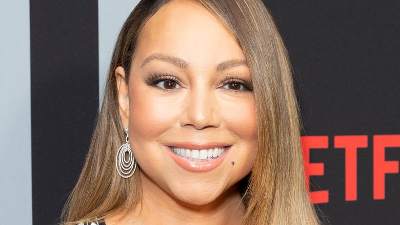 Mariah Carey smiling for cameras