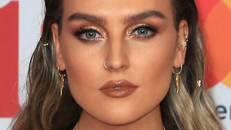 Perrie Edwards gazing in front on the red carpet