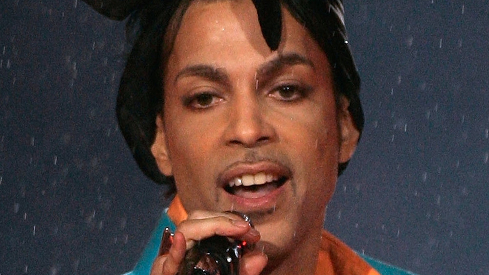 Prince performing on stage