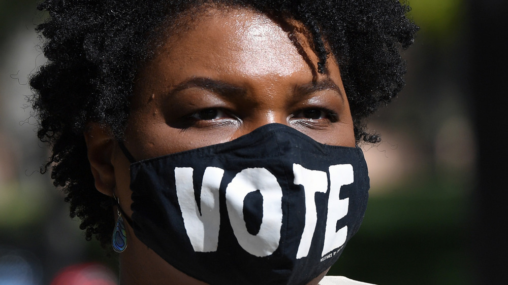 Stacey Abrams wearing a vote face mask