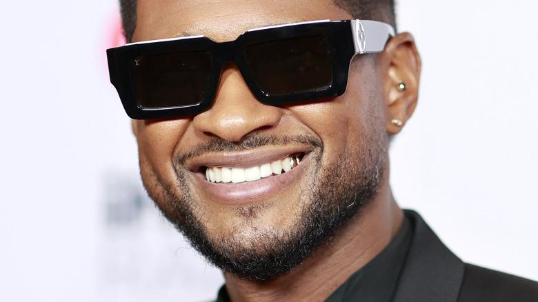 Usher wearing sunglasses