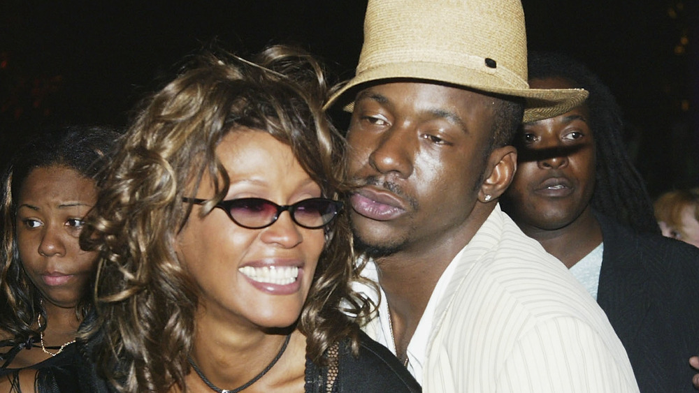 Whitney Houston and Bobby Brown embracing