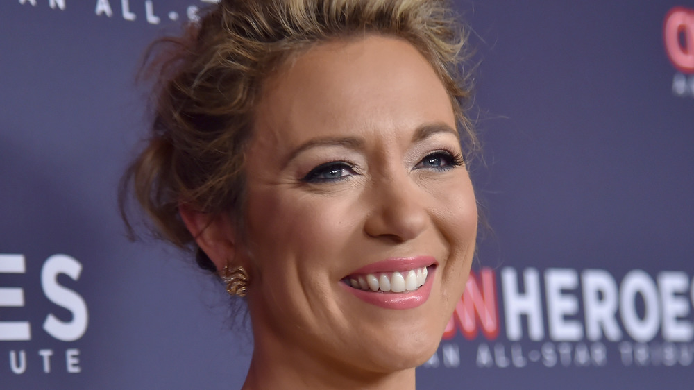 Brook Baldwin smiling at a red carpet event