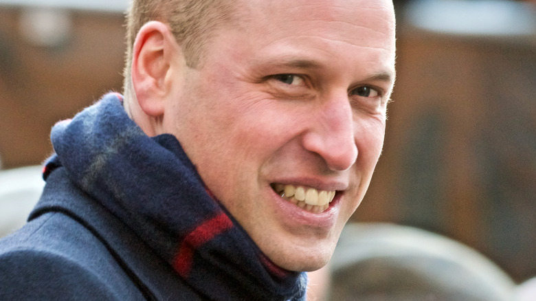 Smiling Prince William wearing scarf