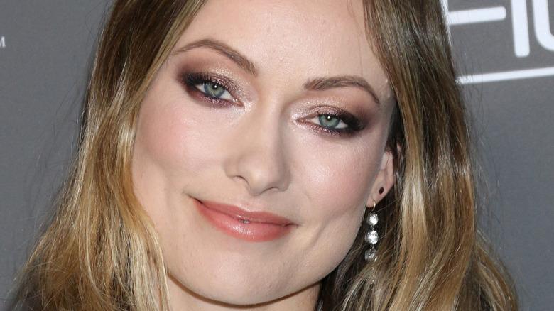 Olivia Wilde smiling gold eyeshadow