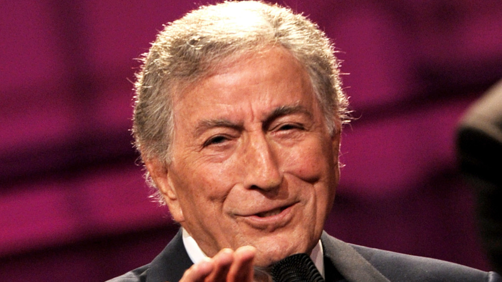 Tony Bennett reaching out while singing