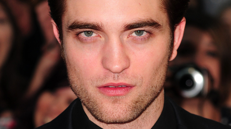Robert Pattinson with a serious expression