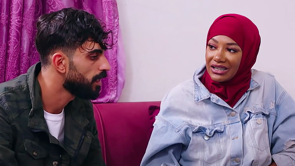 90 Day Fiance's Brittany and Yazan sit on a couchtogether