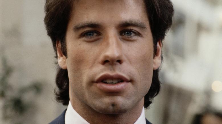 Young John Travolta speaking