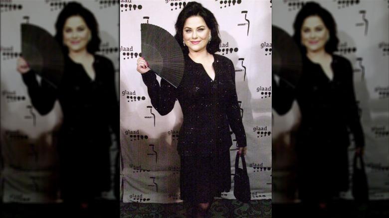 Delta Burke waving fan