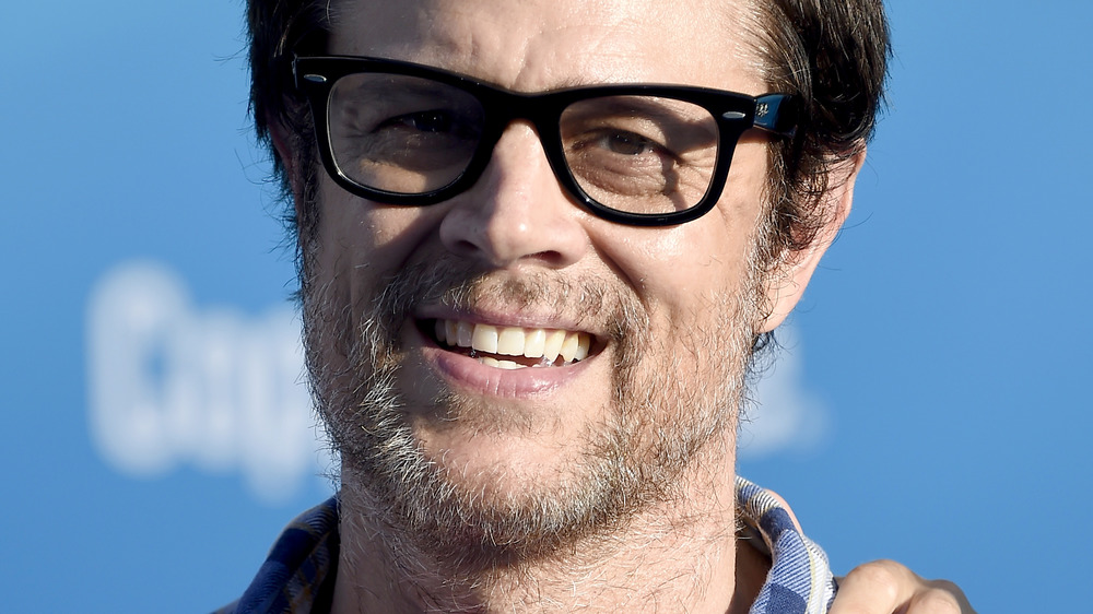 Johnny Knoxville wearing glasses and smiling