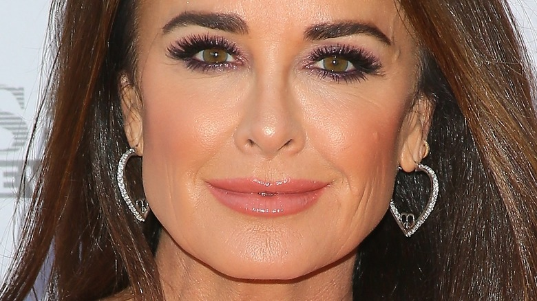 Kyle Richards poses at an event