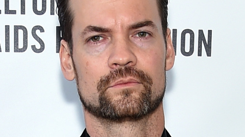 Shane West frowning and posing for photos