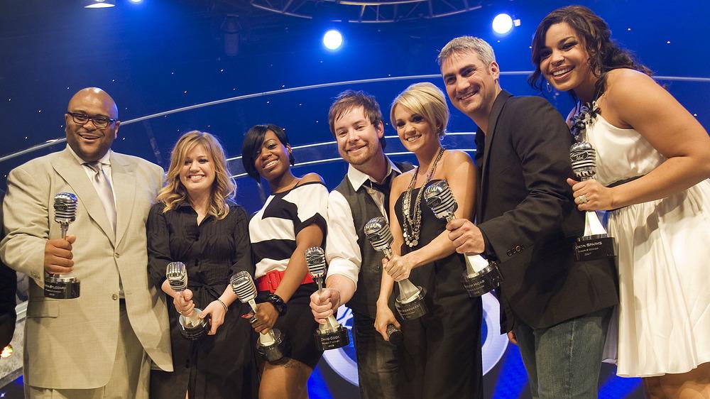 American Idol winners holding awards