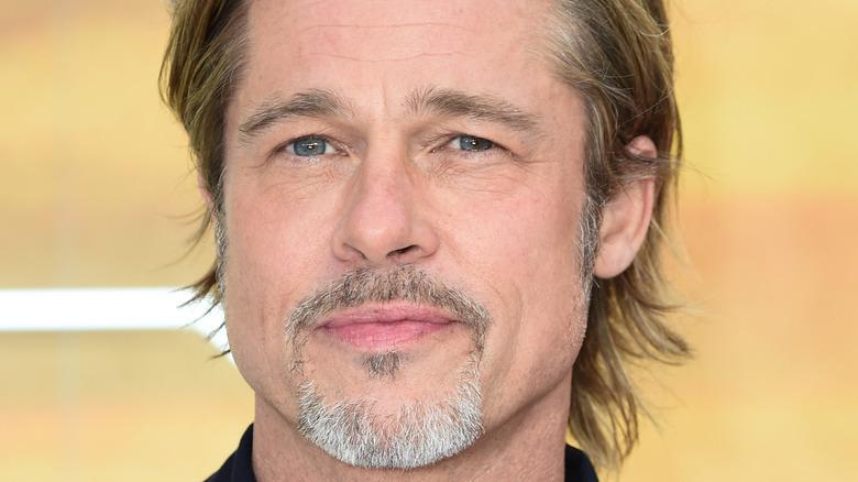 Brad Pitt posing for cameras on red carpet
