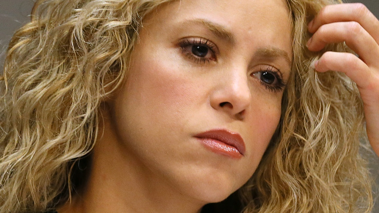 Shakira with a serious expression